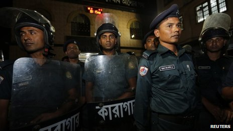 Police stand guard in front of the gate of Dhaka Central Jail.