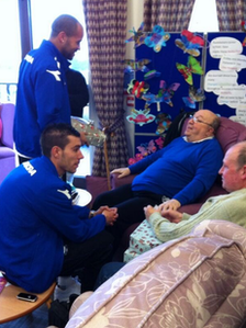 Darren Randolph and Darren Ambrose handing out presents at St Mary's Hospice