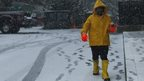 A man makes his way during the arrival of a snowstorm in Jersey City, New Jersey 10 December 2013