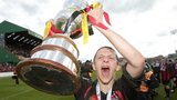 Crusaders player Matthew Snoddy celebrates with the Setanta Cup in 2012