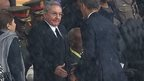 US President Barack Obama shakes hands with Cuban President Raul Castro at the FNB Stadium in Soweto, South Africa 10 December 2013