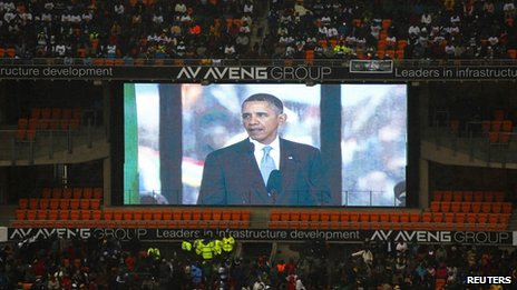 Barack Obama on a screen at Nelson Mandela's memorial event