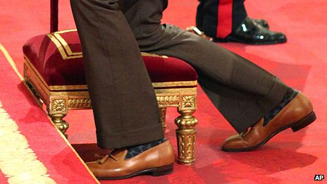A view of Sir Bradley Wiggins's bell-bottomed trousers and loafers
