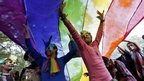 Participants dance under a a rainbow flag as they attend the sixth Delhi Queer Pride parade, an event promoting gay, lesbian, bisexual and transgender rights, in New Delhi November 24, 20