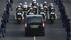 The funeral cortege of South African former president Nelson Mandela leaves the Military Hospital in Pretoria on December 11, 2013 to the Union Buildings marking the start of a three-day lying in state