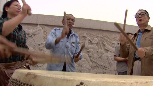 Drummers pounding out a beat for Dancing Grannies in China