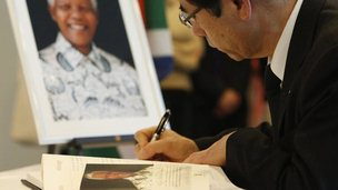 Man signs condolence book for Nelson Mandela