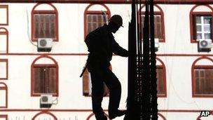 Construction worker stands on scaffolding at a building in the northern Greek port city of Thessaloniki