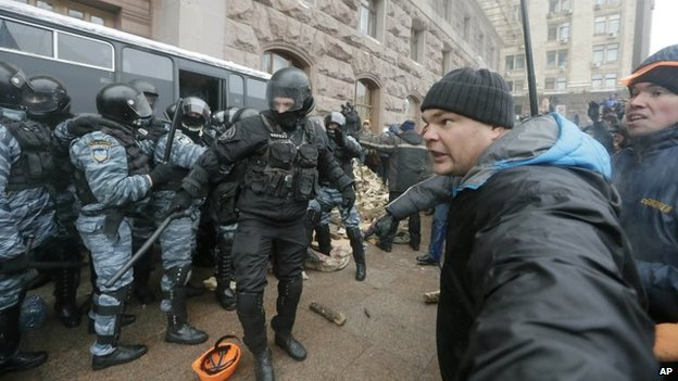Riot police officers clash with pro-European Union activists near the entrance of city hall in Kiev, Ukraine, on Wednesday