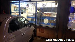 Car driven into fish and chip shop