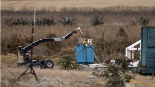 A robotic arm recovers radioactive cobalt-60 and deposits it in a safe container in a field in central Mexico on 10 December, 2013