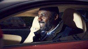 Idris Elba at the wheel of a car