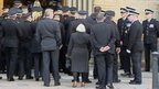 Mourners arrive at funeral