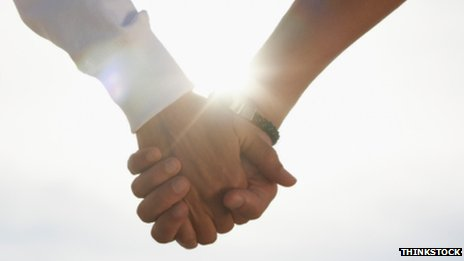 Holding hands - stock image