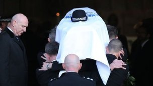 Coffin carried into cathedral