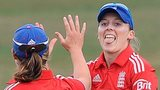 Heather Knight of England celebrates catching Jodie Fields of Australia with team mate Anya Shrubsole (left)