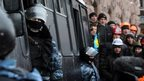 Protesters confront anti-riot police in Kiev, on Wednesday