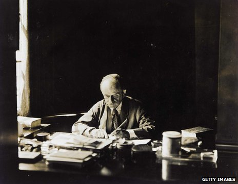 JM Barrie at his desk in his Adelphi Terrace House