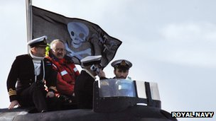 Submarine flying the Jolly Roger
