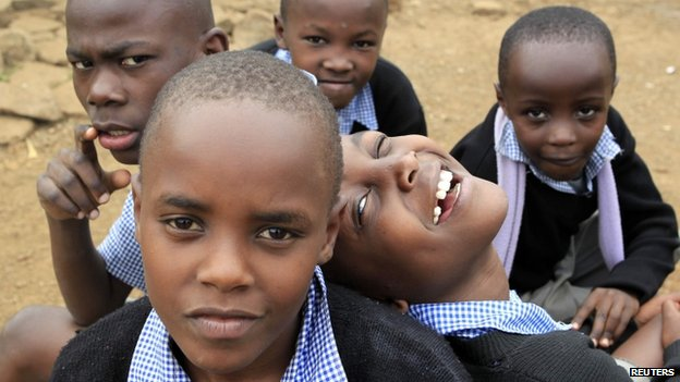 Children pose for a photograph outside their classrooms in Nairobi, Kenya - June 2013