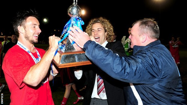 Sergio Torres, Matt Tubbs and Steve Evans celebrate Crawley's promotion to the Football League
