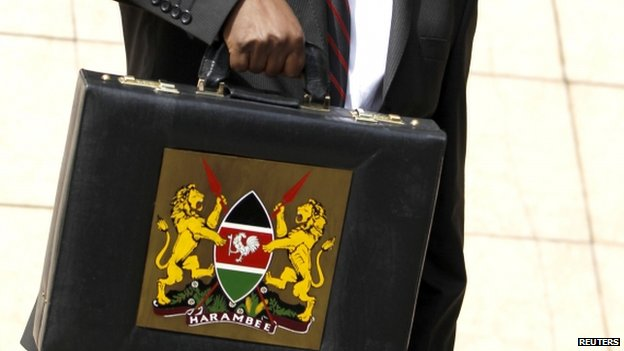 Kenya's finance minister holding up a briefcase containing the budget in Nairobi - June 2013