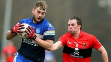 Mayo star Aidan O'Shea in action for DIT in this year's Sigerson final as he is challenged by UCC's Peter Acheson