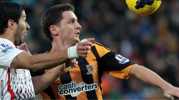 Hull City defender Alex Bruce in action against Liverpool