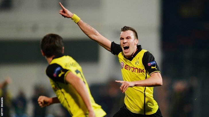 Kevin Grosskreutz celebrates scoring for Dortmund