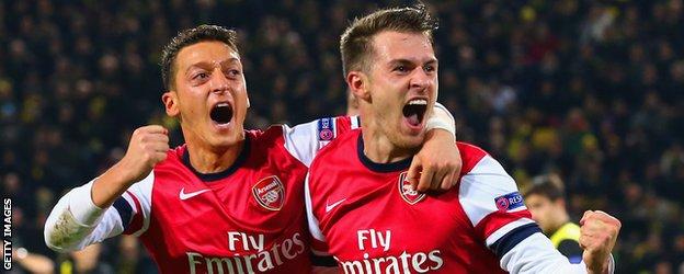 Mezut Ozil and Aaron Ramsey celebrate