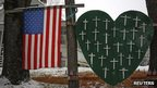 A memorial honouring the victims killed in the Sandy Hook Elementary School shooting is seen outside a home in Sandy Hook, Connecticut, on 10 December 2013