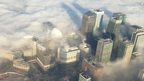 London covered by fog seen from a police helicopter