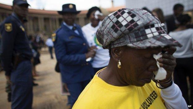 Emotional mourner at lying in state of Nelson Mandela in Pretoria on 11 December 2013