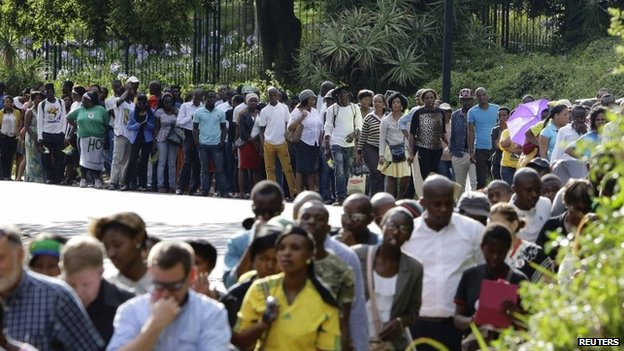 People queue to view the body of Nelson Mandela lying in state in Pretoria on 11 December 2013