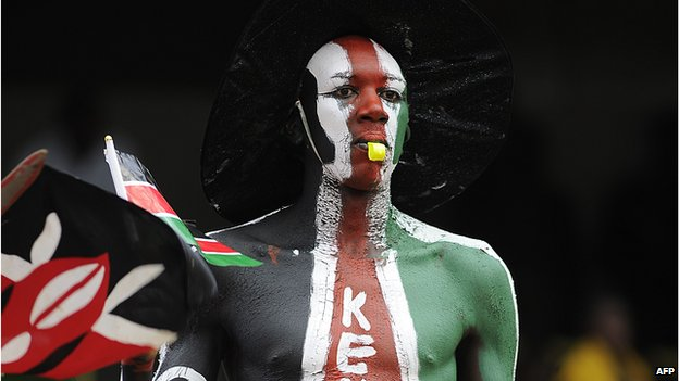 A man painted in the colours of the Kenyan flag at the 50th anniversary celebrations