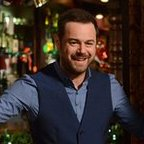 Danny Dyer as Mick Carter at the doors of the Queen Vic