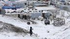 Syrian refugees play with snow during a winter storm in Zahle town, in the Bekaa Valley December 11, 2013