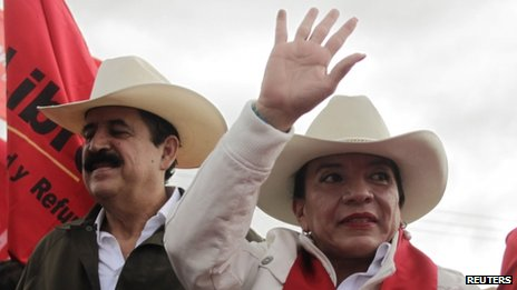 Xiomara Castro (right) and her husband Manuel Zelaya participate in a protest against the results of the presidential election in Tegucigalpa on 1 December, 2013