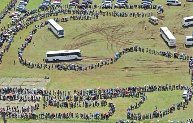 People queue for busses before heading to the Union Buildings in Pretoria, South Africa