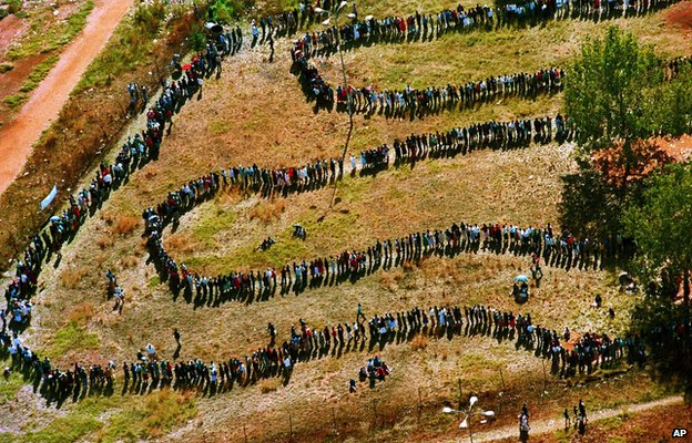 A long line of people wait outside the polling station in Soweto to vote in South Africa's first all-race elections