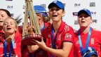 England captain Charlotte Edwards lifts the Ashes trophy in 2013