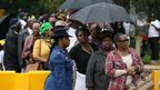 Visitors line up to view the body of former South African president Nelson Mandela as he lies in state at the Union Buildings on December 12, 2013 in Pretoria, South Africa.