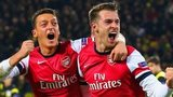Mesut Ozil and Aaron Ramsey celebrate