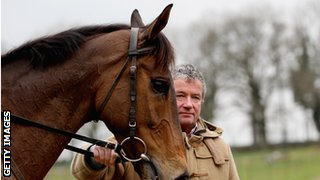 Nigel Twiston-Davies with one of the horses he trains