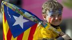 "A boy carries a Catalan flag at an independence ""human chain"" rally in Barcelona, 11 September 11"