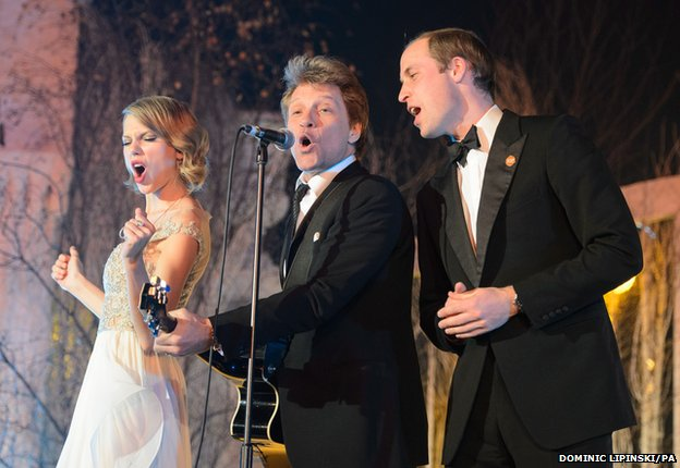 The Duke of Cambridge (right) sings with Taylor Swift (left) and Jon Bon Jovi at the Centrepoint Gala Dinner at Kensington Palace, London
