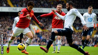 Sandro challenges Shinji Kagawa during the Barclays Premier League Match between Tottenham Hotspur and Manchester United.