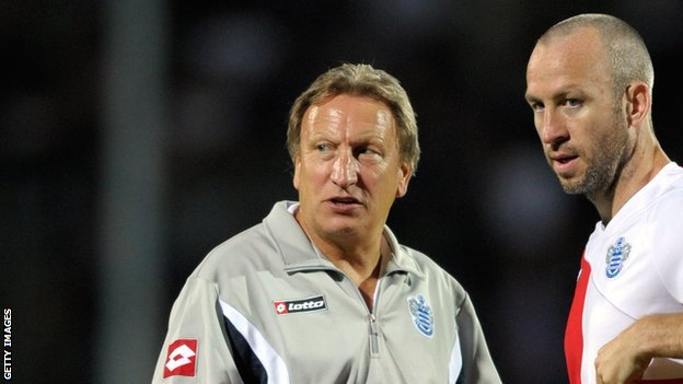 Neil Warnock (left) and Shaun Derry at QPR