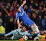 Chelsea's John Terry (right) challenges for the ball with Steaua Bucharest's forward Federico Piovaccari