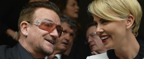 Bono with Charlize Theron